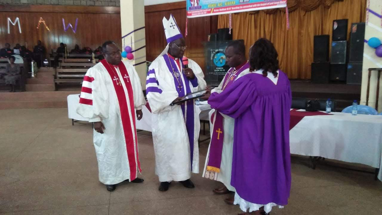 Bishop Muli with his grace Arch Bishop Arthur Kitonga and Bishop Kepha Omae during consecration ceremony in 2019